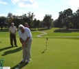 Rick Nichols putting. He was the only one who got it in the hole.